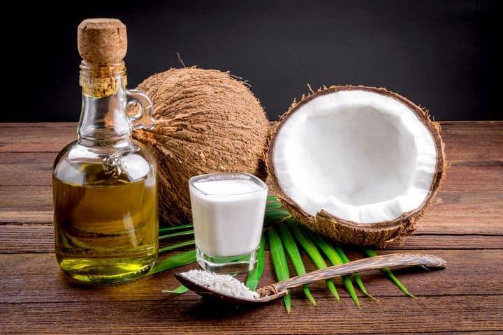 split coconut, coconut milk, and coconut oil