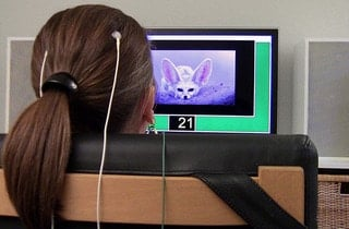 girl in neurofeedback therapy session