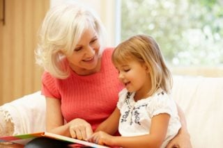 older woman reading to young girl