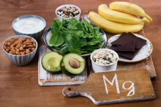 foods containing magnesium -- avocado, nuts, dark chocolate, bananas, leafy green vegetables