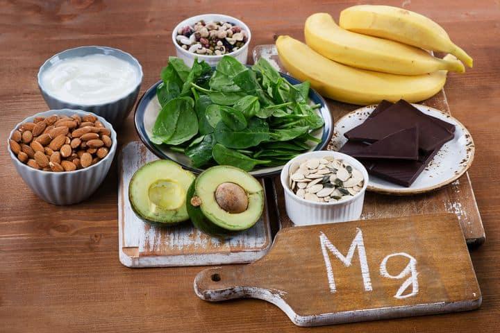 foods containing magnesium -- avocado, nuts, dark chocolate, bananas, leafy green vegetables