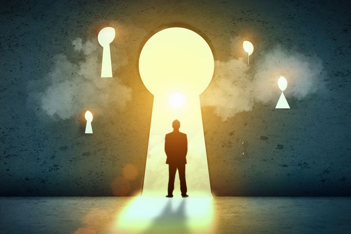 graphic of a man standing in large keyhole