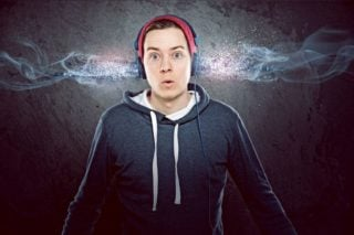 photo depicting man with headphones on acting surprised