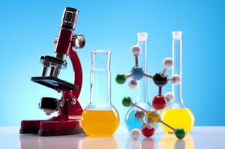 laboratory equipment - microscope, beakers, molecule models