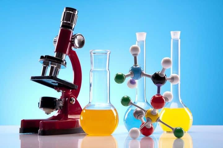 laboratory equipment - microscope, beakers, molecule models