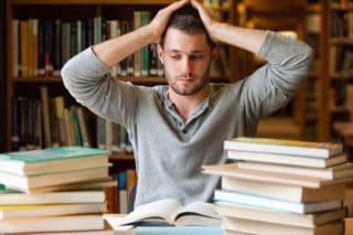 photo of man looking overwhelmed by studying