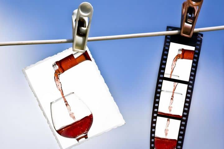 photo showing a photo and a strip of photo negatives of red wine being poured