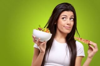 woman choosing between healthy and unhealthy foods