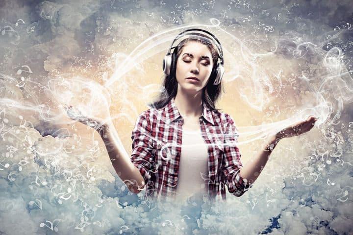 woman wearing headphones meditating