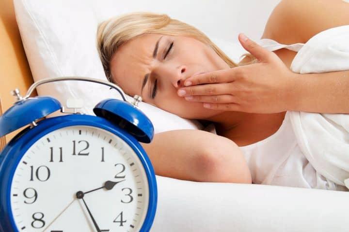 photo depicting woman unable to sleep
