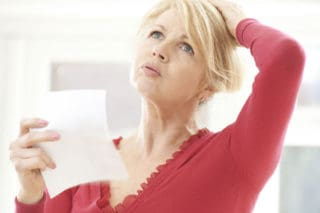 photo of menopausal woman fanning herself