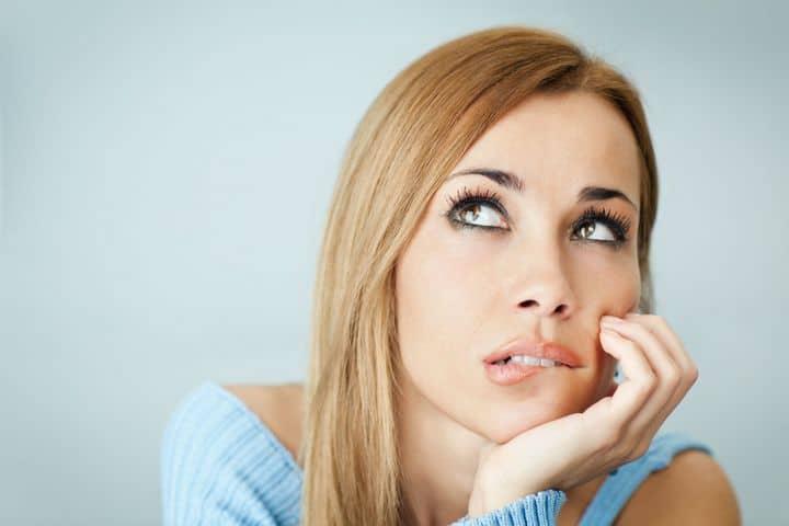 woman looking doubtful