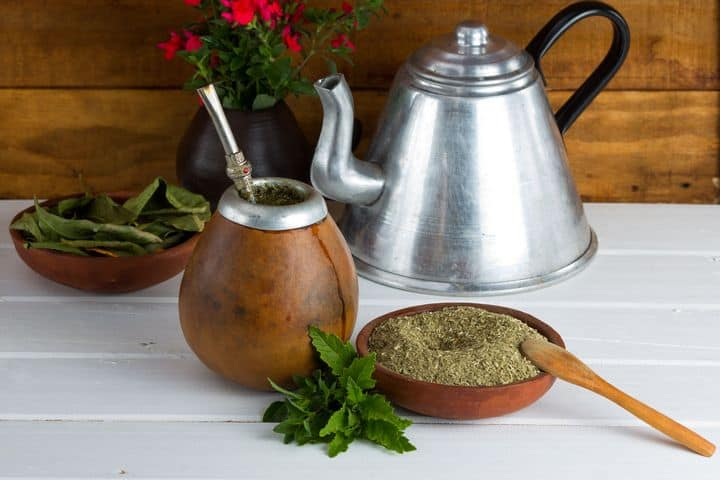 photo of yerba mate tea leaves, teapot, and gourd for drinking